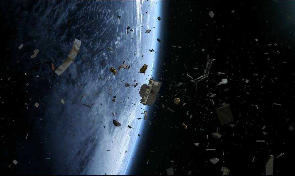 time to clean up the thousands of dead satellites orbiting earth