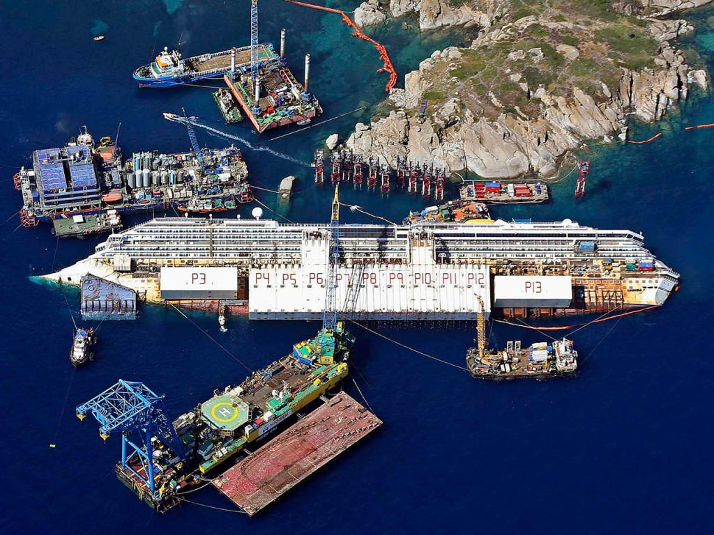 An aerial view shows the Costa Concordia as it lies on its side next