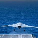 US Navy Tests Fighter Jet and Drone's Simultaneous Takeoff from an Aircraft Carrirer