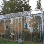 Swedish Couple Built a Glass House around Home to Keep Warm and Grow Food