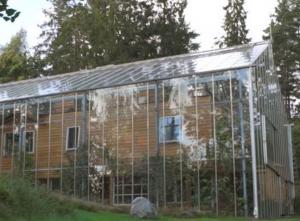 Swedish Couple Built a Glass House around Home to Keep Warm and Grow Food